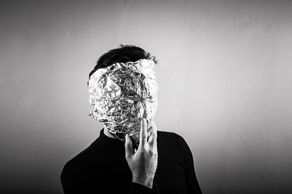Man with foil over his face